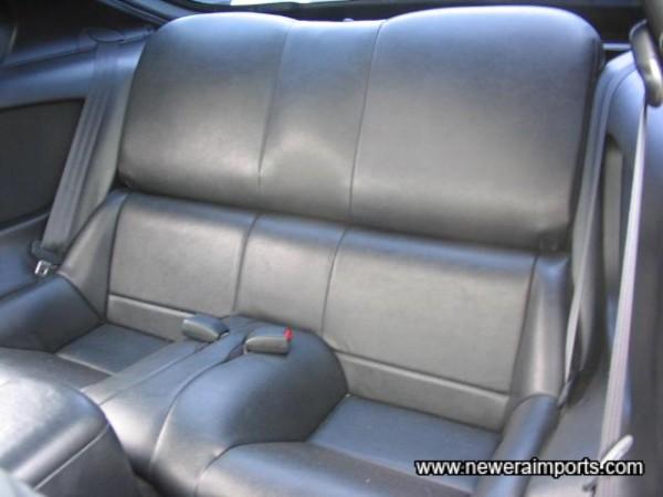 Standard rear seat (Vinyl, not leather).