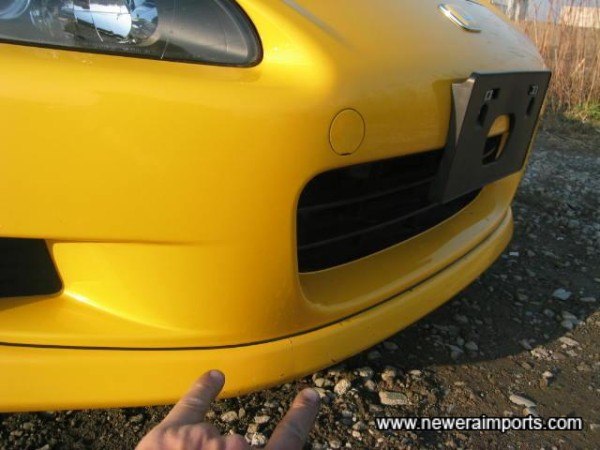 Just a tiny scratch to the (optional) front lip spoiler.