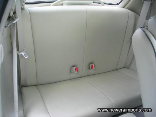 Rear seat is unmarked.