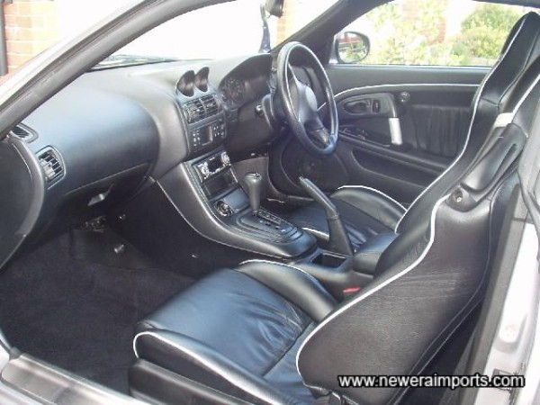 Bespoke leather interior is still as new.