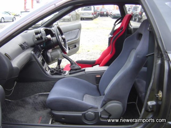 Interior with only a red seat to give away intentions of this car.