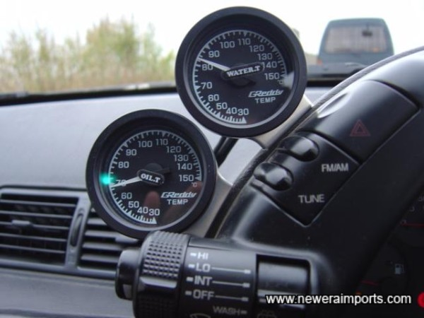 GReddy oil temp & water temp gauges.