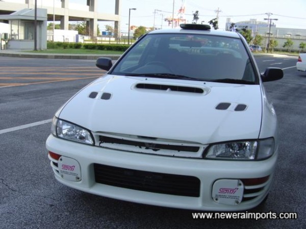 Facelift bonnet and STI 5 clear headlights.