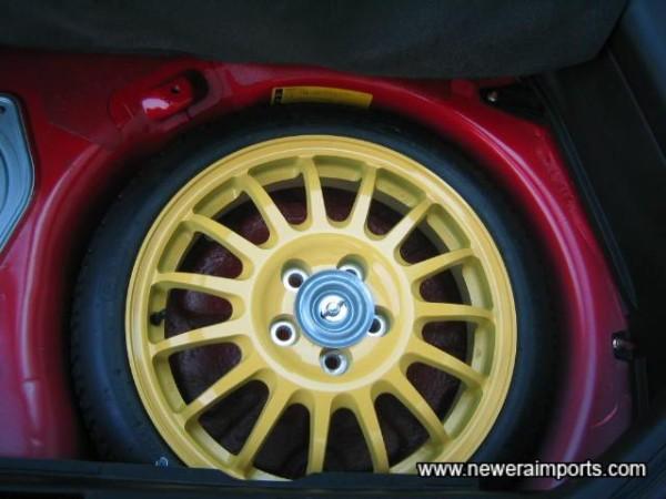 Unused lightweight magnesium spare wheel.
