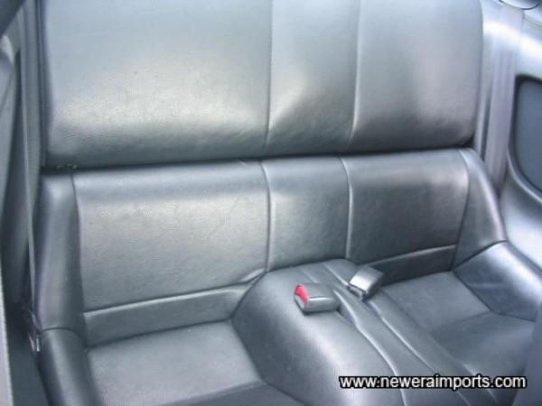 Original vinyl rear seat.