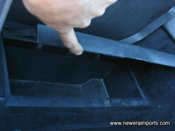 Storage compartment behind seats