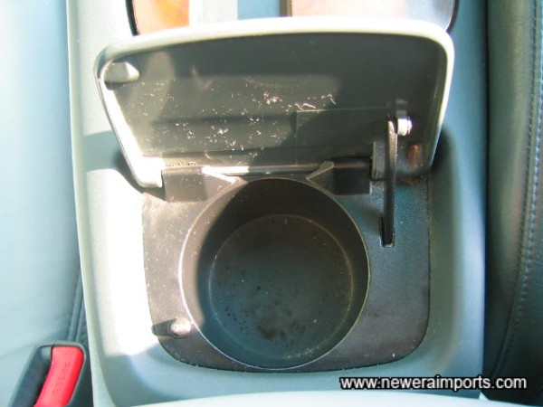 A non smoker's car from new. There is no ashtray, instead there's a cup holder.