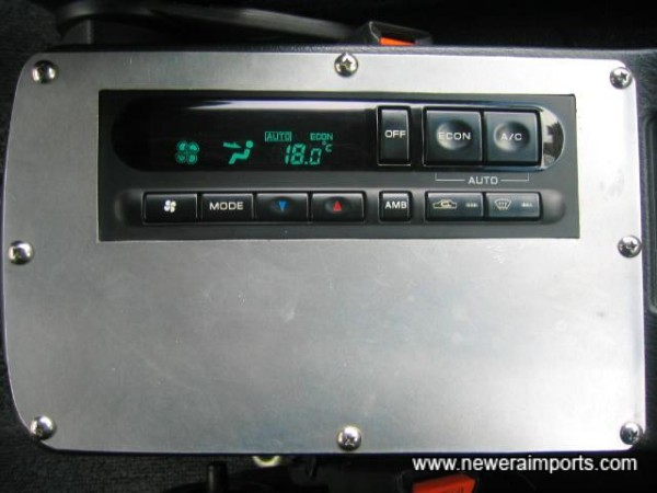 A/C control module is located on the centre console.