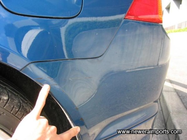 Scratches to rear bumper - To be repaired perfectly as part of UK preparation.