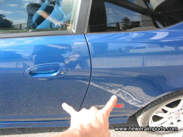 Tiny pin dent on door & rear quarter - To be repaired perfectly as part of UK preparation.