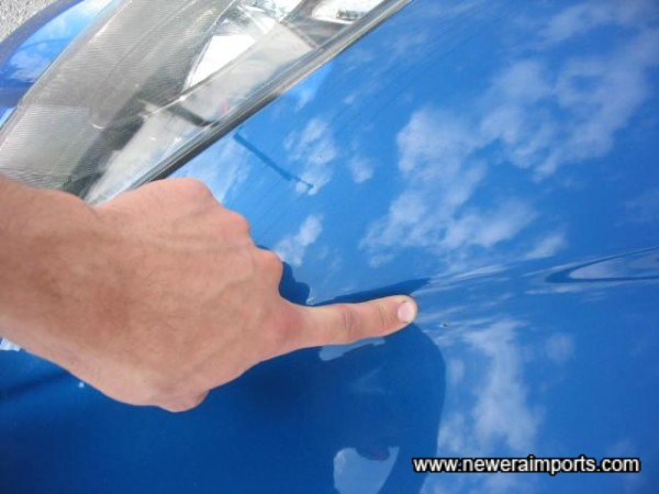 Tiny stone chip on bonnet - To be repaired perfectly as part of UK preparation.