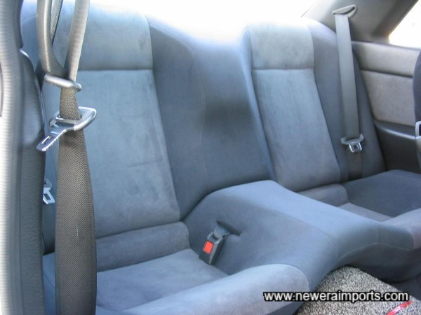 Unmarked original rear seat.