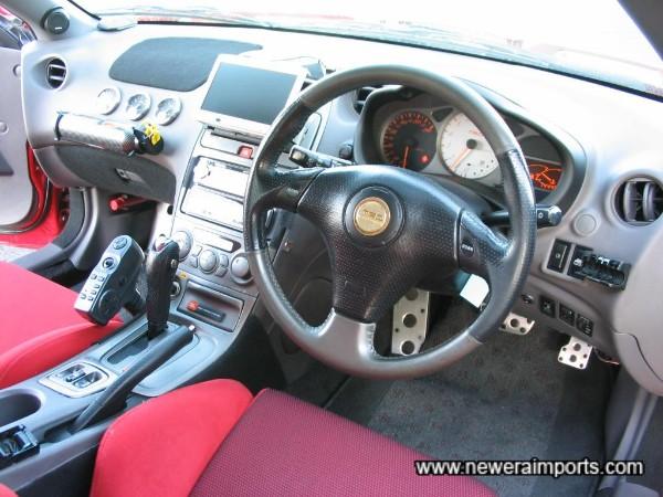 TRD emblem on steering wheel centre.