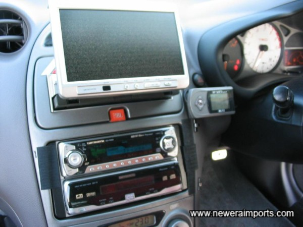 2nd TV folds into the dashboard electrically.