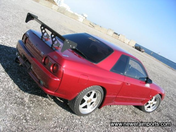 Titanium exhaust, GT Wing and dark rear windows. JDM Class!