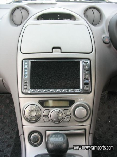 Factory Option Stereo, A/C Controls and Storage Compartment