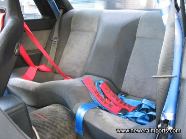 Note the passenger's harness, loosely stored on the rear seat.