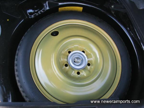 Original unused spare wheel.