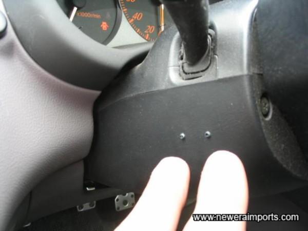 Small screw holes to steering column trim. Very minor.
