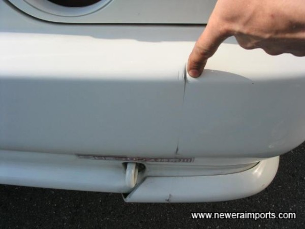 Rear Bumper minor ding - To be repaired as part of UK preparation.