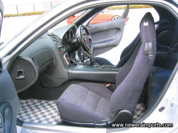 Alcantara suede seats are in excellent original condition.
