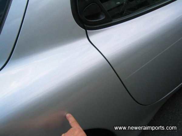 Small pin dent on o/s quarter - to be repaired as part of UK preparation.