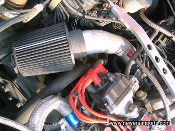 AEM / K&N Air induction kit.... This car has serious induction roar!