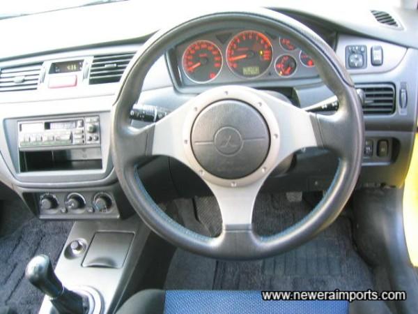 Original Momo steering wheel also unworn.