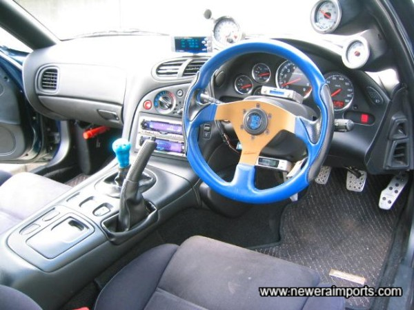 The bright blue steering wheel can be replaced with a more subtle black item, upon request.