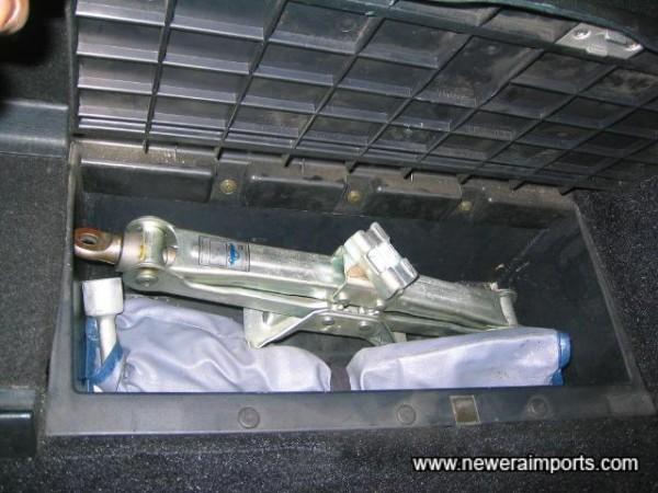 Original tools complete & unused. In storage bin behind driver's seat.