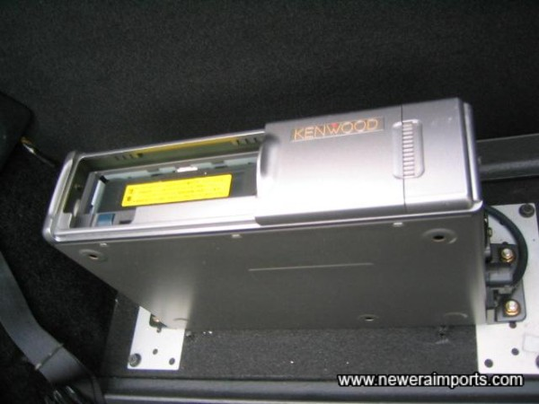 10 CD Disc changer located aft of the passenger seat.