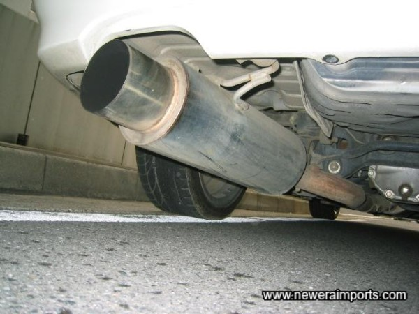 Stainless Nismo exhaust from the catalyts back.