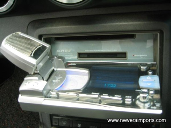 CD & MD slots are accessible at the touch of a button.
