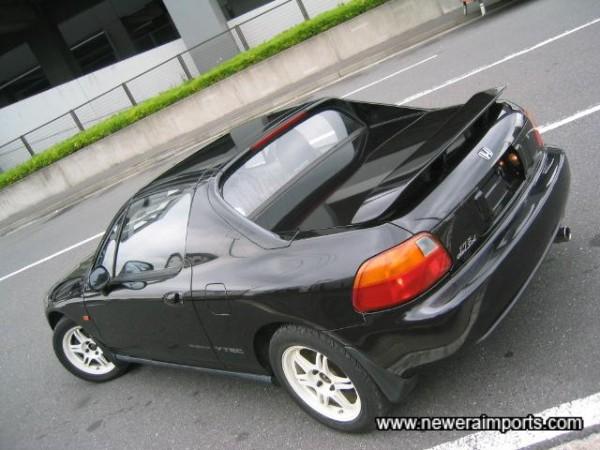 Original rear spoiler with integrated brake light.