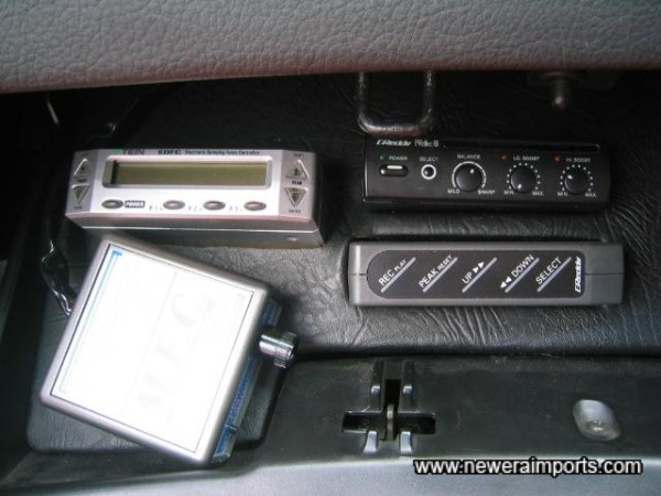 Controllers neatly mounted in the glovebox.