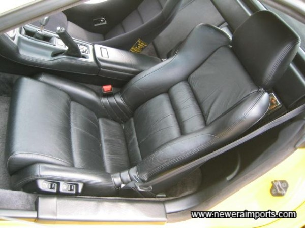 Passenger seat is electrically adjustable.