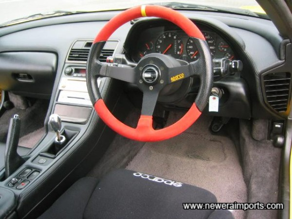 Sparco suede trimmed steering wheel. Very comfortable on skin.