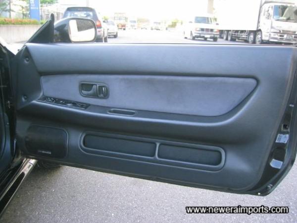 Driver's door panel also unmarked.