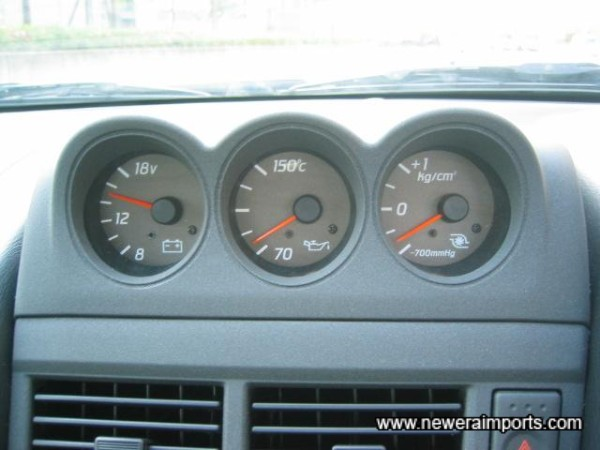 Original gauges mounted in the cenrte of the dashboard.