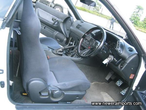 Interior's unworn condition reflects low genuine mileage.