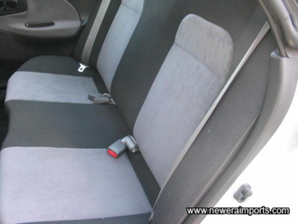 Rear seats unworn and unmarked of course.