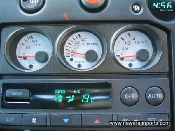 Nismo centre console gauges.