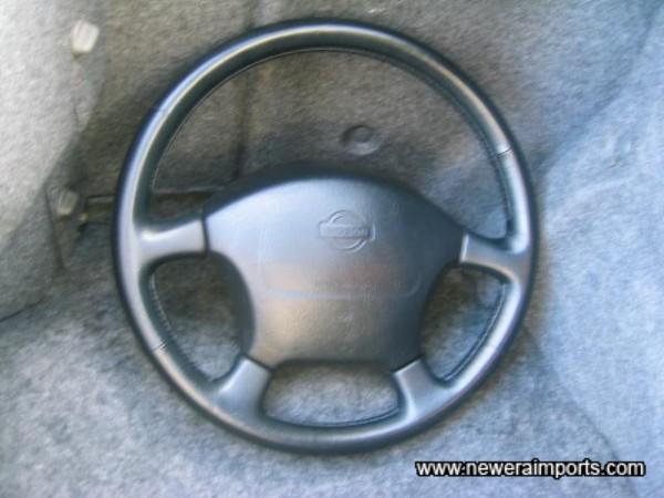Original Steering wheel is included.