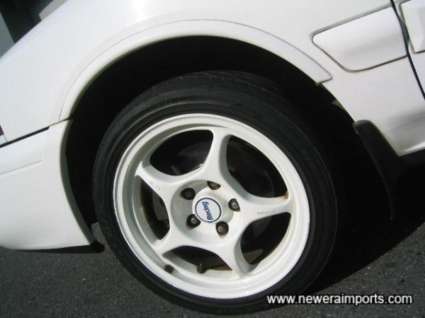 Enkei Racing forged lightweight alloys.