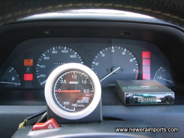 Boost controller and gauge mounted where they can be easily seen and adjusted.