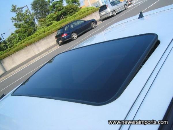 Glass sunroof (Tilt slide, electric of course).