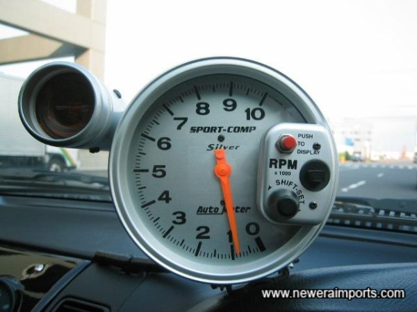 Race style tachometer with pre-settable shift light.