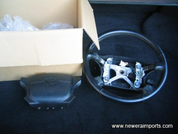 Original airbag steering wheel comes with the car.