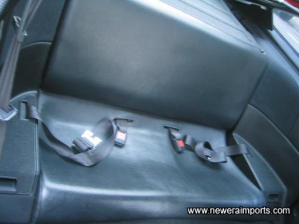 Rear seat is unmarked.