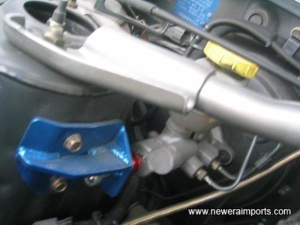 Brake Master Cylinder stop = for improved brake pedal feel.